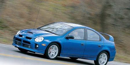 Tire, Wheel, Motor vehicle, Blue, Automotive design, Vehicle, Automotive mirror, Rim, Car, Automotive wheel system,