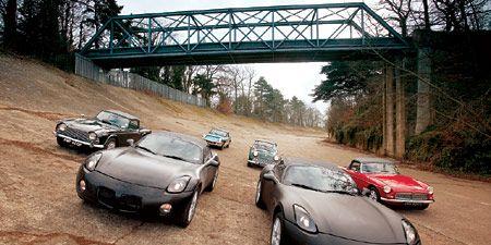 Mode of transport, Vehicle, Automotive design, Land vehicle, Car, Automotive parking light, Performance car, Bridge, Sports car, Supercar,