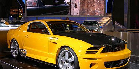 Tire, Motor vehicle, Wheel, Automotive design, Vehicle, Yellow, Hood, Headlamp, Automotive tire, Automotive lighting,