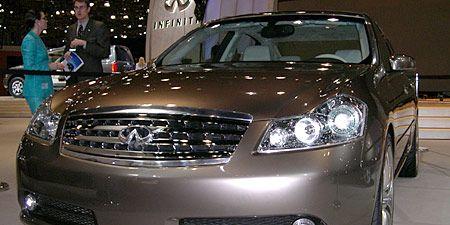 Automotive design, Vehicle, Grille, Automotive lighting, Headlamp, Car, Hood, Glass, Automotive mirror, Automotive exterior,