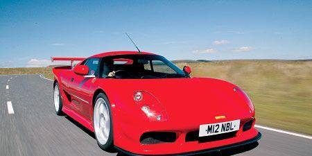 Mode of transport, Automotive design, Vehicle, Road, Performance car, Car, Red, Plain, Supercar, Automotive exterior,