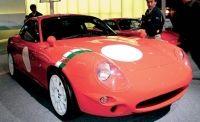 Motor vehicle, Mode of transport, Automotive design, Vehicle, Transport, Land vehicle, Car, Red, Photograph, Hood,