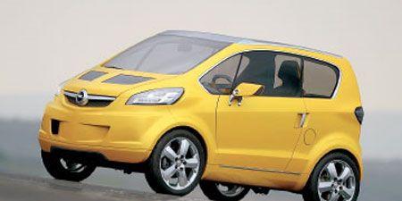 Tire, Wheel, Motor vehicle, Automotive mirror, Mode of transport, Automotive design, Vehicle, Yellow, Transport, Automotive wheel system,