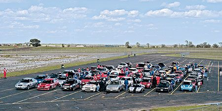 Motor vehicle, Plain, Motorsport, Parking lot, Automotive parking light, Parking, Automotive exterior, Land lot, Automotive lighting, Touring car racing,