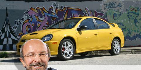 Tire, Motor vehicle, Wheel, Automotive design, Yellow, Vehicle, Land vehicle, Transport, Alloy wheel, Rim,