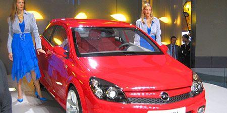 Motor vehicle, Automotive design, Vehicle, Event, Land vehicle, Car, Automotive lighting, Red, Dress, Fender,