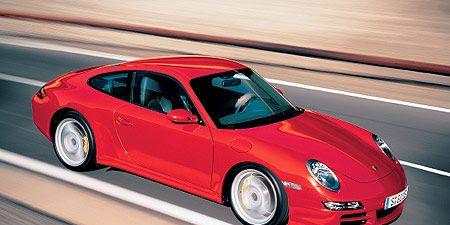 Tire, Wheel, Automotive design, Vehicle, Alloy wheel, Rim, Road, Car, Red, Automotive lighting,