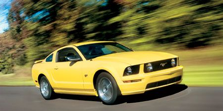 Motor vehicle, Mode of transport, Automotive design, Daytime, Yellow, Transport, Vehicle, Road, Infrastructure, Hood,
