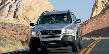 Motor vehicle, Tire, Wheel, Automotive mirror, Road, Mode of transport, Vehicle, Land vehicle, Automotive lighting, Transport,