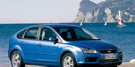 Motor vehicle, Tire, Wheel, Mode of transport, Automotive design, Blue, Transport, Vehicle, Automotive mirror, Coastal and oceanic landforms,