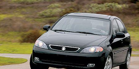 Tire, Automotive mirror, Automotive design, Daytime, Vehicle, Land vehicle, Glass, Hood, Headlamp, Automotive lighting,