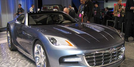 Tire, Motor vehicle, Wheel, Mode of transport, Automotive design, Vehicle, Land vehicle, Event, Car, Grille,