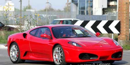 Tire, Wheel, Mode of transport, Automotive design, Transport, Vehicle, Land vehicle, Infrastructure, Car, Red,