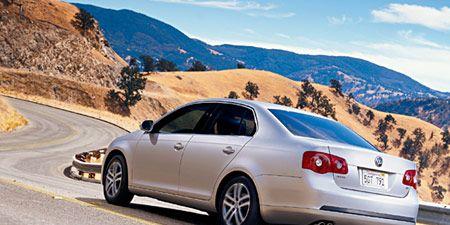 Tire, Motor vehicle, Wheel, Mode of transport, Road, Vehicle, Automotive tail & brake light, Mountainous landforms, Land vehicle, Automotive design,