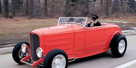 Tire, Mode of transport, Automotive design, Vehicle, Transport, Automotive lighting, Red, Photograph, Classic car, Car,