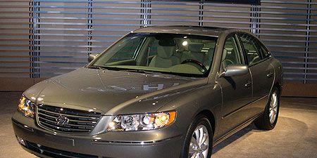 Tire, Glass, Vehicle, Automotive parking light, Hood, Car, Automotive lighting, Headlamp, Rim, Full-size car,