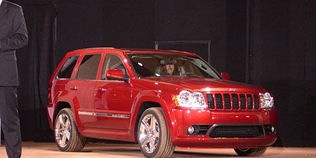 Tire, Motor vehicle, Automotive design, Product, Vehicle, Automotive tire, Automotive lighting, Car, Rim, Red,