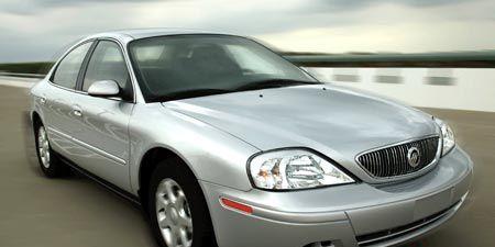 Mode of transport, Daytime, Vehicle, Glass, Transport, Hood, Automotive lighting, Window, Headlamp, Infrastructure,