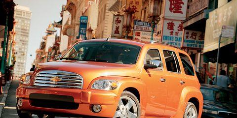 Tire, Motor vehicle, Wheel, Transport, Automotive mirror, Vehicle, Road, Automotive design, Window, Automotive parking light,