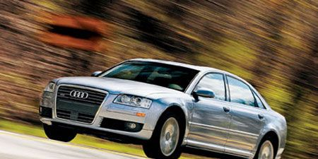 Tire, Wheel, Automotive design, Vehicle, Transport, Infrastructure, Car, Headlamp, Grille, Rim,