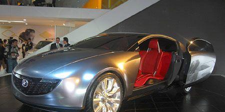 Mode of transport, Automotive design, Vehicle, Event, Land vehicle, Car, Automotive mirror, Automotive lighting, Concept car, Personal luxury car,