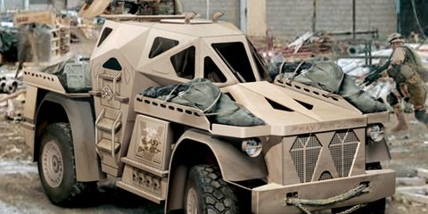 Tire, Wheel, Motor vehicle, Mode of transport, Vehicle, Military vehicle, Automotive tire, Photograph, Armored car, Fender,