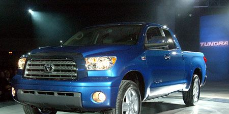 Tire, Motor vehicle, Wheel, Automotive tire, Automotive design, Blue, Vehicle, Automotive mirror, Land vehicle, Automotive lighting,