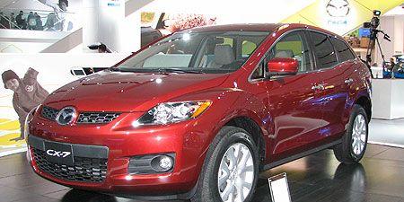 Tire, Wheel, Motor vehicle, Automotive design, Vehicle, Event, Land vehicle, Automotive lighting, Automotive mirror, Car,