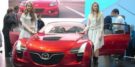 Motor vehicle, Mode of transport, Automotive design, Vehicle, Event, Land vehicle, Car, Personal luxury car, Luxury vehicle, Sports car,