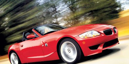 Tire, Automotive design, Mode of transport, Vehicle, Hood, Automotive mirror, Red, Car, Automotive lighting, Automotive parking light,
