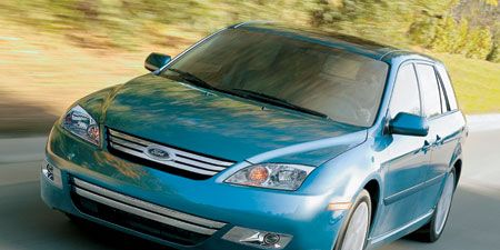 Automotive design, Automotive mirror, Blue, Daytime, Vehicle, Land vehicle, Hood, Car, Transport, Glass,