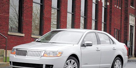 Tire, Wheel, Vehicle, Daytime, Land vehicle, Window, Automotive parking light, Transport, Infrastructure, Headlamp,
