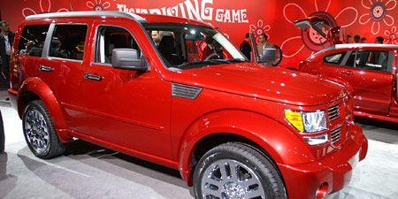 Tire, Motor vehicle, Wheel, Automotive tire, Automotive design, Vehicle, Land vehicle, Rim, Red, Car,