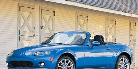 Tire, Wheel, Blue, Automotive design, Vehicle, Hood, Land vehicle, Automotive parking light, Car, Rim,