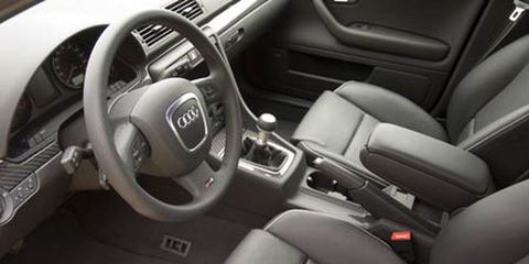 Motor vehicle, Steering part, Automotive design, Steering wheel, White, Car, Center console, Technology, Vehicle door, Automotive mirror,