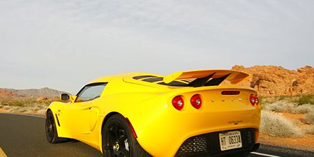 Motor vehicle, Tire, Wheel, Mode of transport, Automotive design, Road, Vehicle, Yellow, Automotive lighting, Land vehicle,
