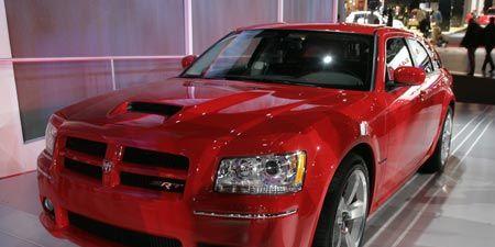 Automotive design, Vehicle, Hood, Red, Car, Automotive lighting, Grille, Fender, Headlamp, Bumper,