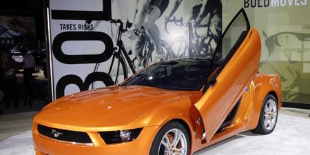 Automotive design, Chevrolet camaro, Hood, Headlamp, Rim, Grille, Vehicle door, Automotive lighting, Fender, Automotive exterior,