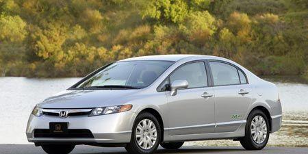 Tire, Wheel, Mode of transport, Automotive mirror, Vehicle, Transport, Car, White, Technology, Alloy wheel,