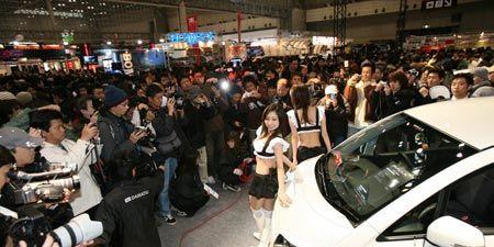 Automotive design, Product, Event, Car, Crowd, Camera, Auto show, Concept car, Alloy wheel, Exhibition,