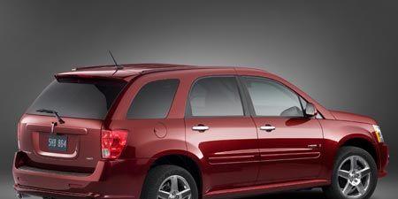 Motor vehicle, Tire, Automotive design, Product, Vehicle, Automotive tail & brake light, Automotive exterior, Automotive tire, Car, Red,
