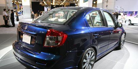 Wheel, Automotive design, Vehicle, Land vehicle, Car, Alloy wheel, Full-size car, Rim, Personal luxury car, Luxury vehicle,