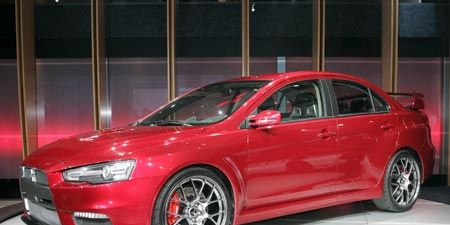 Tire, Wheel, Automotive design, Vehicle, Alloy wheel, Rim, Car, Red, Full-size car, Technology,