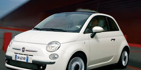 Motor vehicle, Automotive mirror, Mode of transport, Automotive design, Vehicle, Transport, Car, Rim, White, Red,