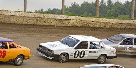 Wheel, Land vehicle, Vehicle, Car, Motorsport, Hood, Auto racing, Mid-size car, Automotive parking light, Racing,