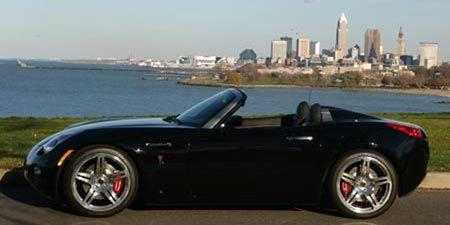 Tire, Mode of transport, Automotive design, Vehicle, Alloy wheel, Rim, Car, Photograph, Red, Performance car,