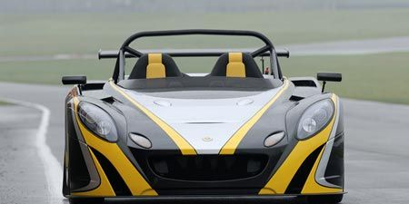 Mode of transport, Automotive design, Yellow, Road, Car, Road surface, Asphalt, Headlamp, Hood, Supercar,