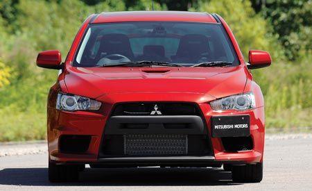 automotive design, automotive mirror, daytime, vehicle, hood, grille, car, red, headlamp, automotive exterior,