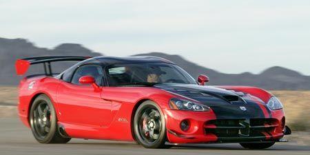 Tire, Wheel, Automotive design, Vehicle, Land vehicle, Hood, Car, Automotive mirror, Red, Performance car,