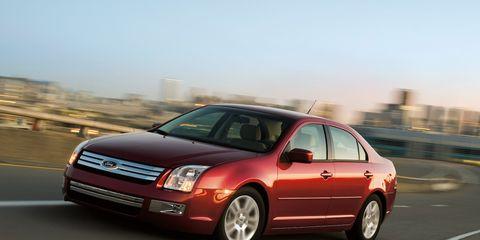 Tire, Wheel, Automotive mirror, Automotive design, Vehicle, Transport, Infrastructure, Glass, Car, Rim,